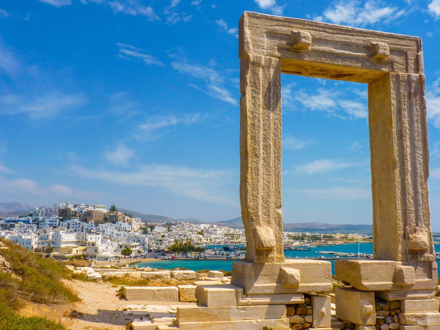 Portara - ruins of ancient temple of Delian Apollo on Naxos island, Cyclades, Greece shutterstock_413482879