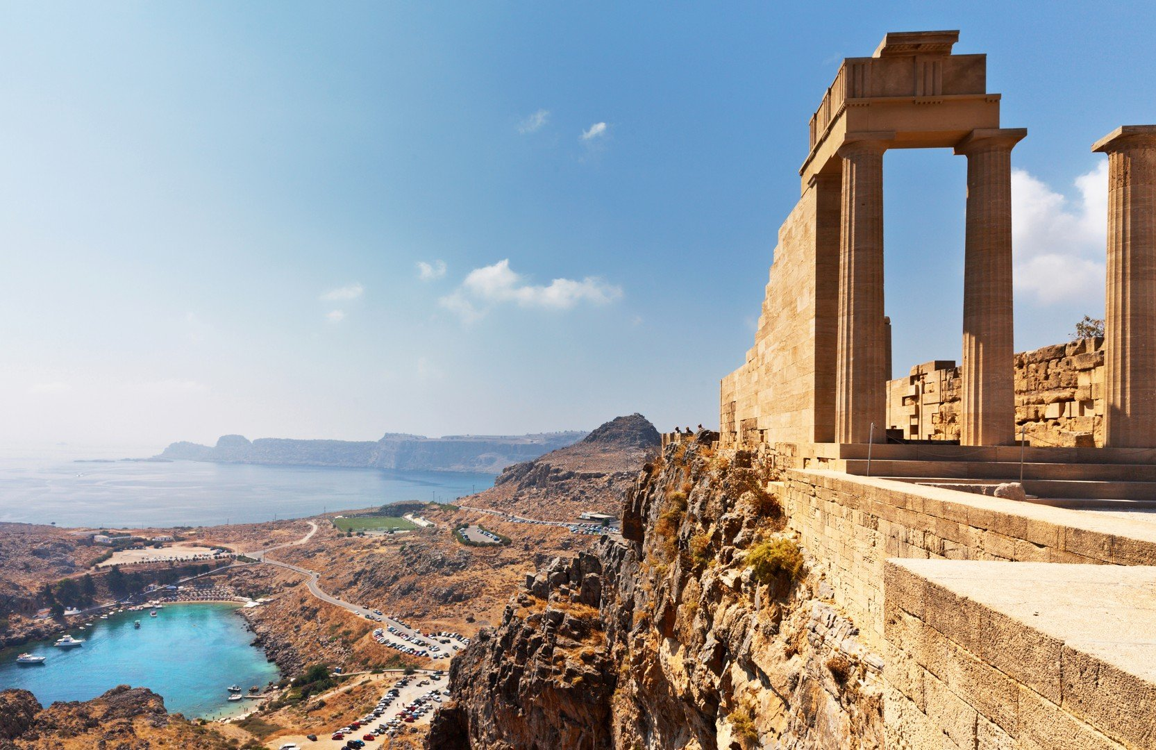 Rhodes Island. Acropolis of Lindos View from the height of the ancient temple of Athena Lindia IV century BC to St Paul's Bay in the form of the heart shutterstock_758688799