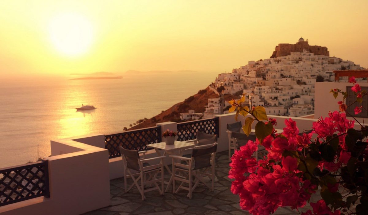 Picturesque castle of Astypalaia island as seen at sunrise through beautiful bougainvillea in blossom, Dodecanese, Greece shutterstock_1509098420