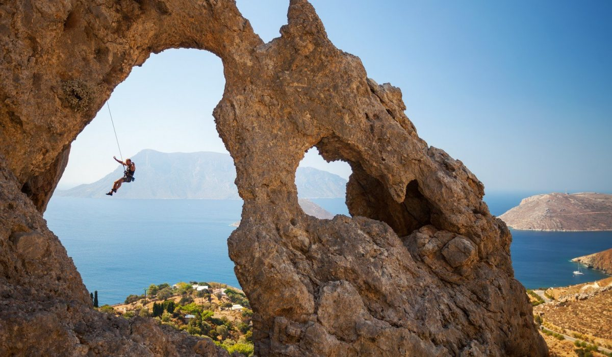 Rock climber falling of a cliff while lead climbing Kalymnos Island, Greece shutterstock_234889021