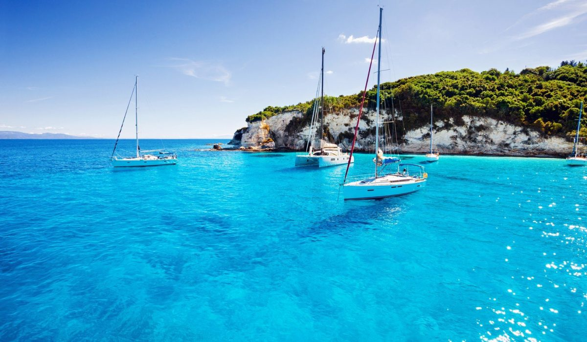 Sailboats in a beautiful bay, Paxos island, Greece - Imagen shutterstock_381164851