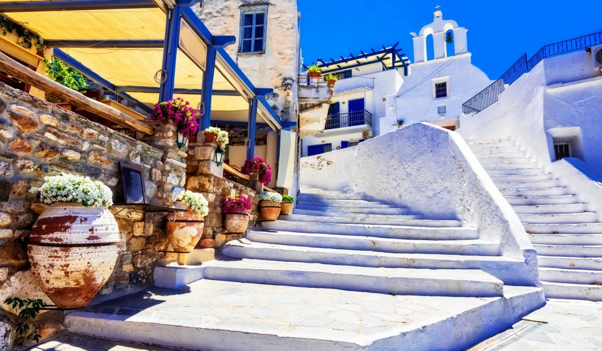Traditional Greece - charming floral streets with tavernas, Naxos island shutterstock_1031619217