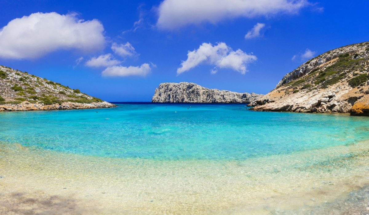Turquoise crystal beaches of Greece - Kounoupa in Astypalea island shutterstock_452415847