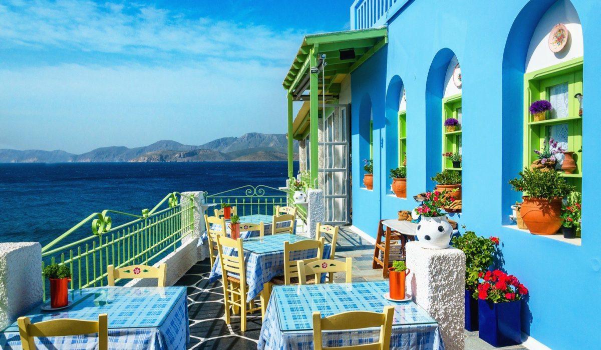 Typical blue and white Greek restaurant Kalymnos Dodecanese Islands Greece Imagen shutterstock_283189580