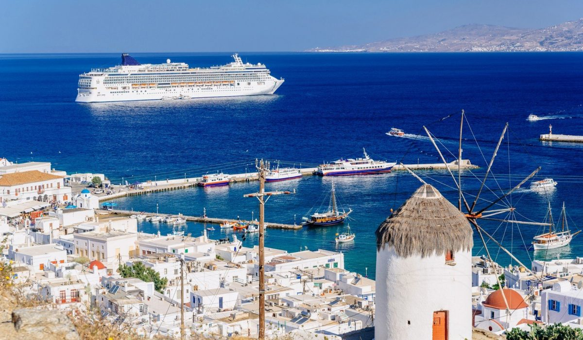 View above Mykonos town with a whitewashed windmill and a cruise ship, Mykonos island, Cyclades, Greece shutterstock_393550972