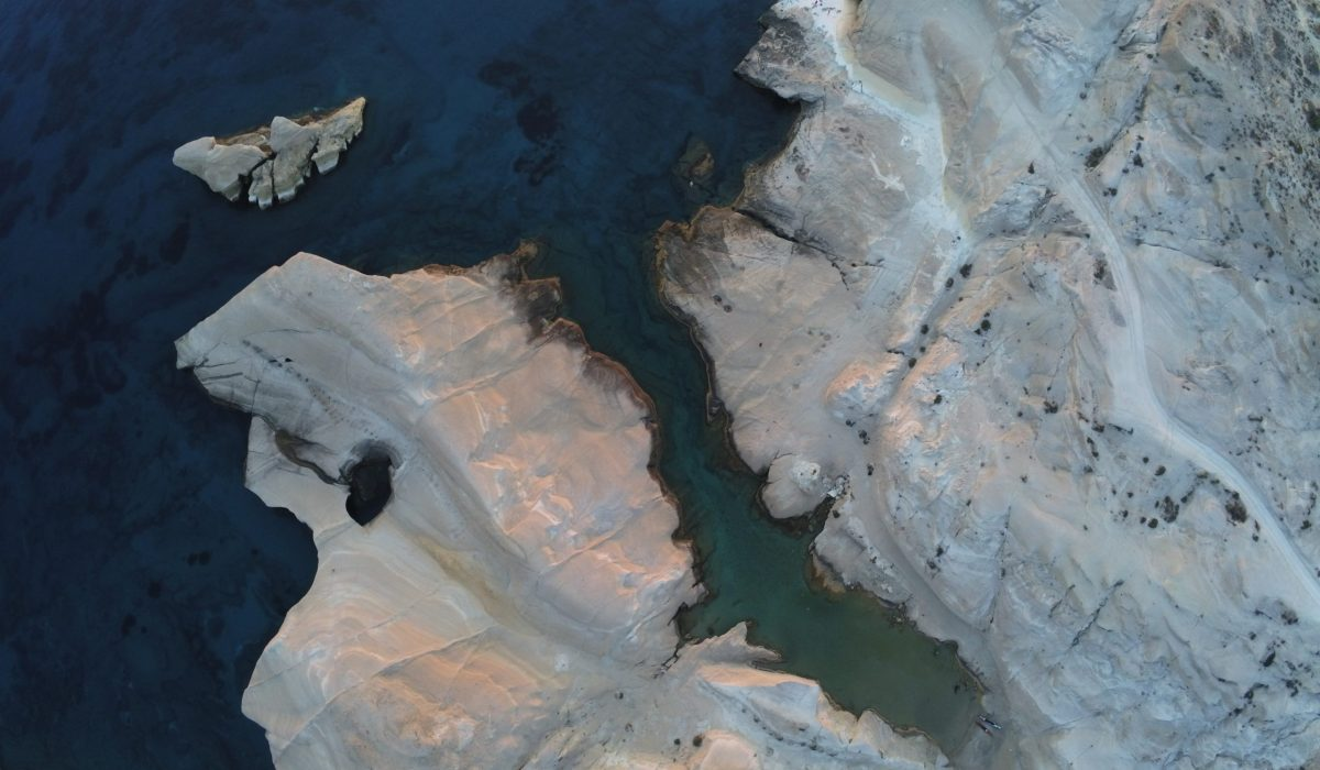 white ice on body of water during daytime top-view photography